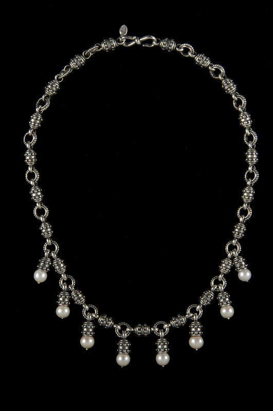 Sterling Silver link necklace with eight Pearl drops by Bowman Originals, Sarasota, 941-302-9594.