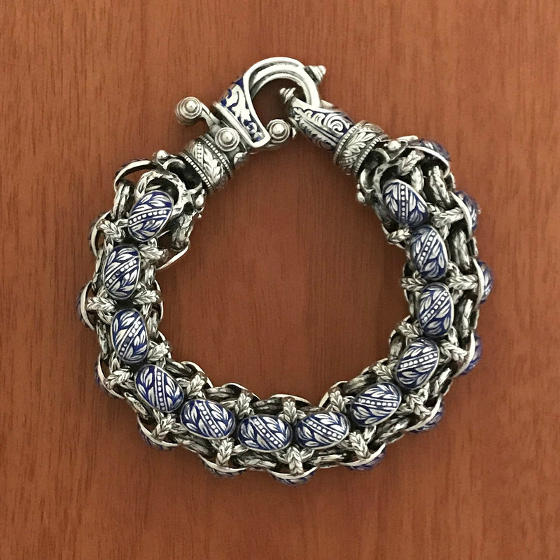 "Rolled Laurel Leaf ""Hook"" Bracelet handmade in Sterling Silver and accented with Vitreous Cobalt Blue Enamel by Bowman Originals, Sarasota, 941-302-9594"