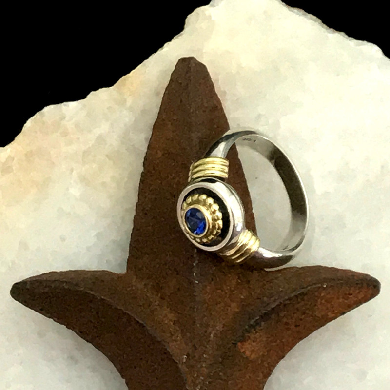 Cornflower Blue Sapphire featured in this handmade Sterling Silver and 18 k Gold ring by Bowman Originals, Sarasota, 941-302-9594.