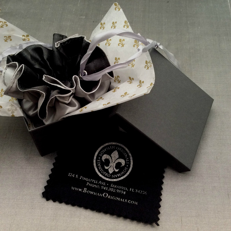 Packaging for fine handmade jewelry by Bowman Originals, Sarasota, 941-302-9594.