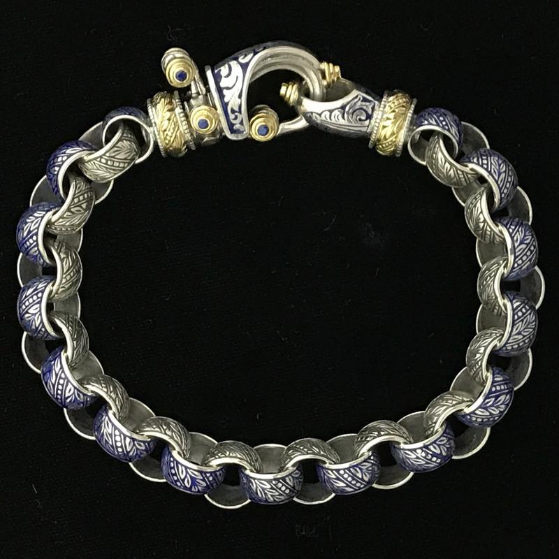 "Silver, Gold, Enamel ""Hook"" Bracelet handmade by Bowman Originals, Sarasota, 941-302-9594."