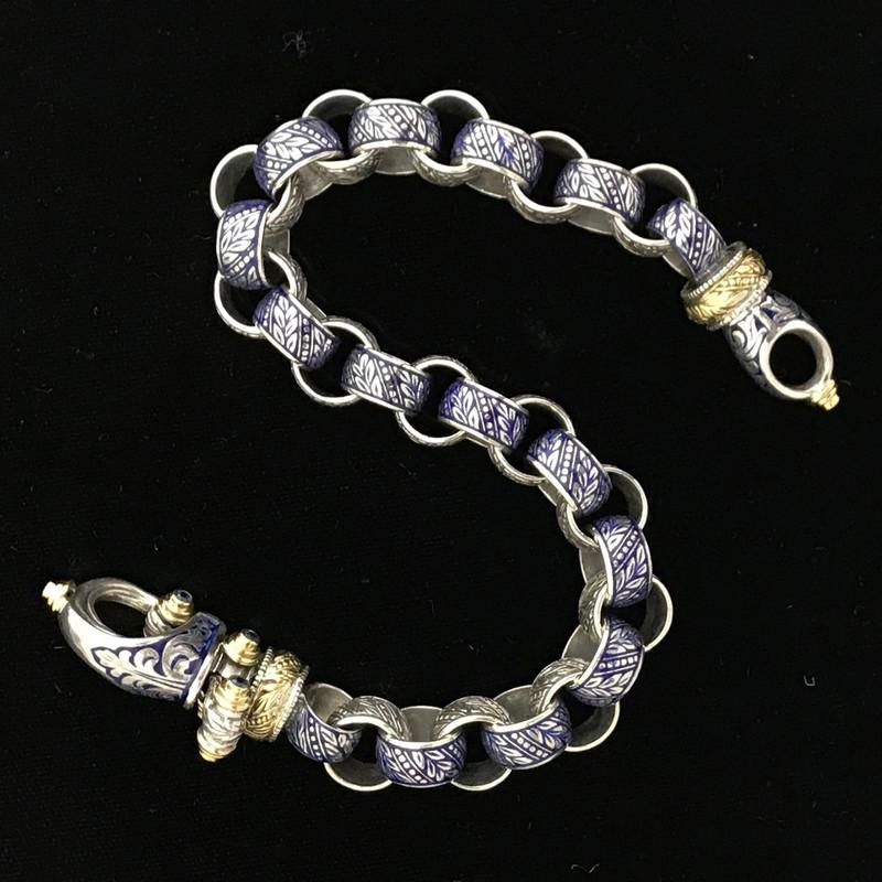 Sterling Silver,  18 k Gold, Enamel and Blue Sapphire Bracelet handmade by Bowman Originals, Sarasota, 941-302-9594.