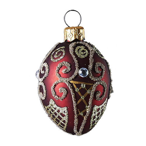 Ruby oval with gold design work Christmas ornament