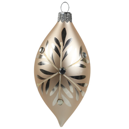 A delicate, elegant creamy glass olive decorated with a silver flake as a symbol of snow and Christmas, complemented by tiny stones.