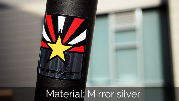 Rounded corner mirror silver sticker on a scooter