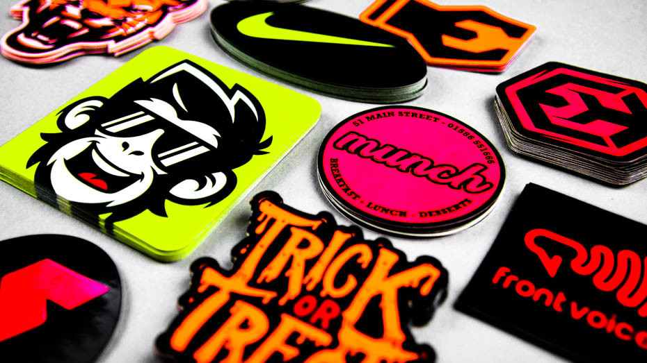 Piles of fluorescent stickers on a light grey table