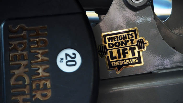 Weights don't lift themselves sticker applied to a weight bench