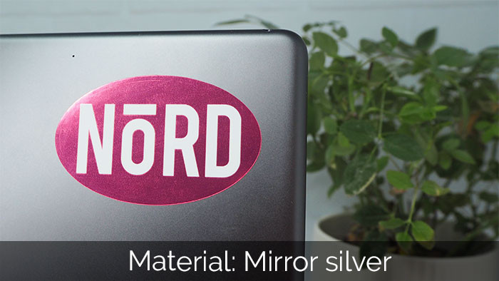 Mirror silver Nord oval sticker applied to an iPad