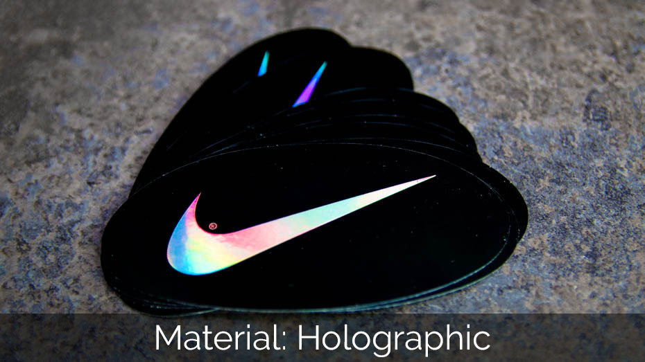 A pile of Nike oval holographic stickers on a stone slab