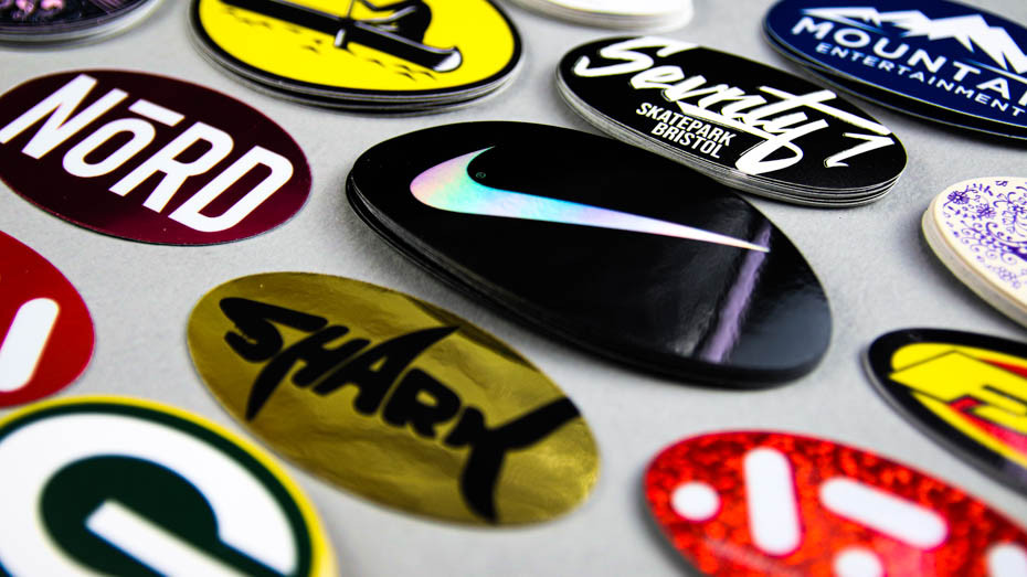 Piles of oval stickers on a light grey table