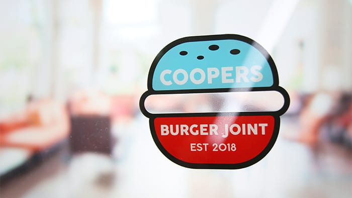 Coopers burger joint custom die cut front adhesive window sticker on a shop window