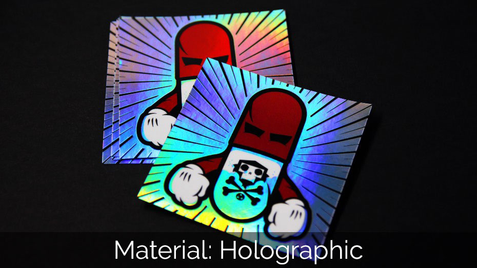A pile of holographic square stickers on a black background