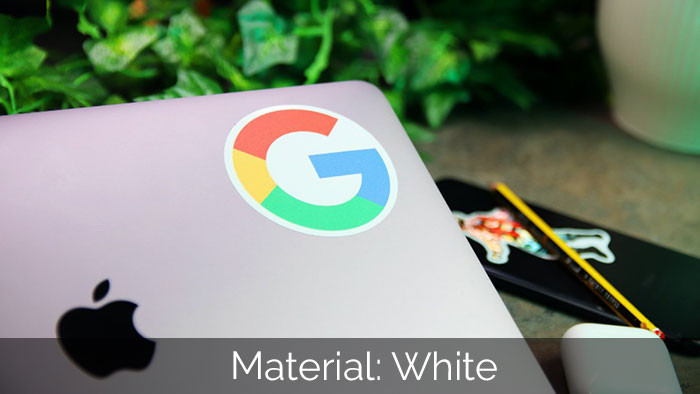 Google white vinyl circle sticker applied to a laptop with a plant in the background