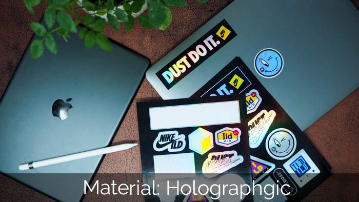 Nike holographic sticker sheets with DUST DO IT sticker applied to a laptop