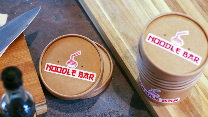 Noodle bar die cut white vinyl stickers applied to deli cups
