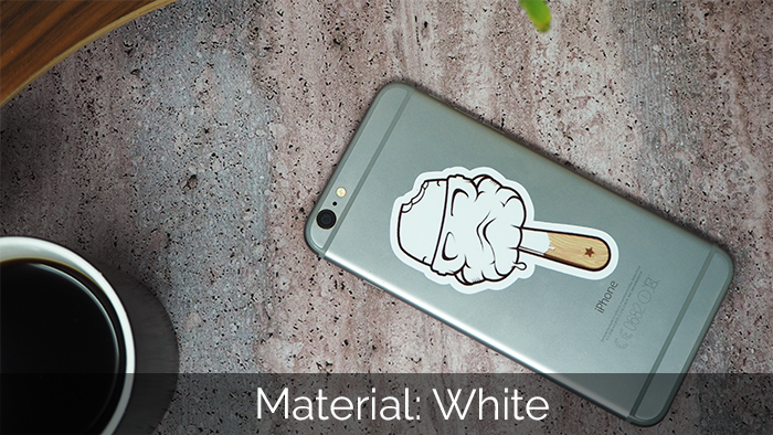 Ice cream custom shaped, full colour sticker on the back of a space grey Apple iPhone mobile lying on concrete table