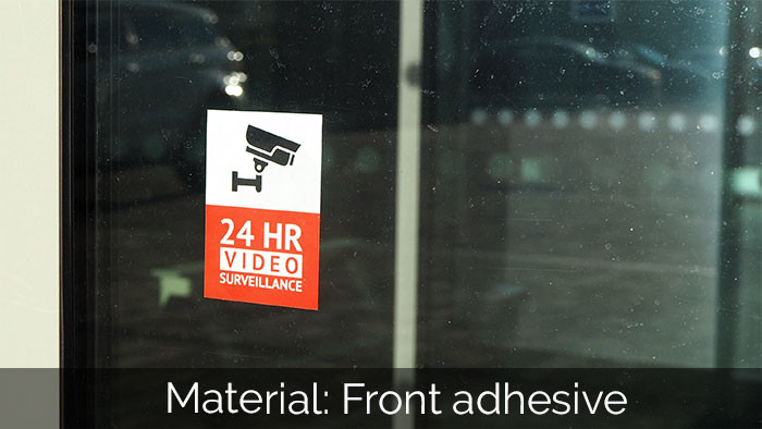 24hr security rectangle front adhesive sticker applied to the inside of a window