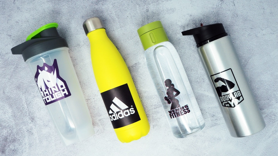 Various full colour custom printed stickers applied to water bottles on a grey background