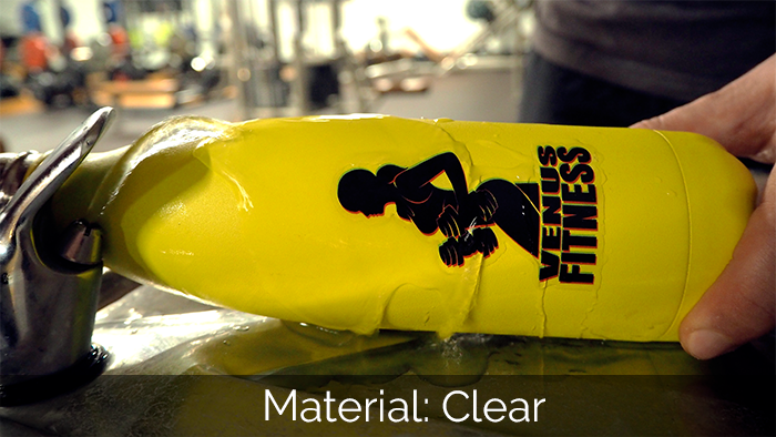Clear die cut water bottle sticker on a yellow water bottle being filled with water