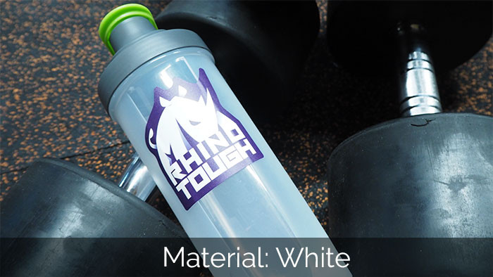 Rhino tough sticker on a semi-transparent water bottle in the gym with dumbells