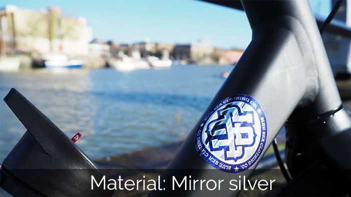 Circular silver sticker on a bike in Bristol harbour in the UK