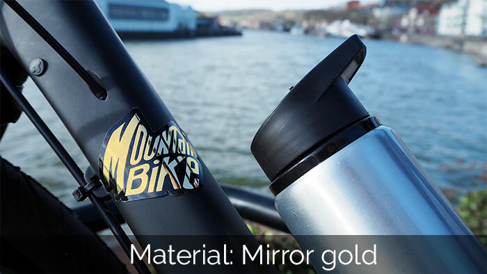 Mountain bike sticker applied to a frame with a silver water bottle and water in the background
