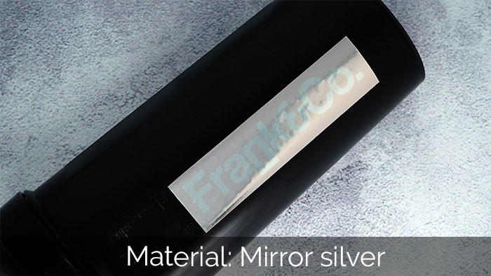A light pink rectangle mirror silver sticker on a black water bottle