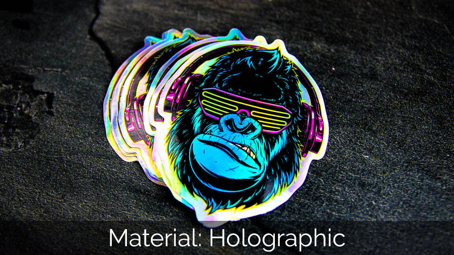 A pile of cool gorilla die cut holographic sticker samples on a work surface