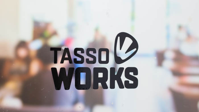 Black tasso works transfer sticker on an office window