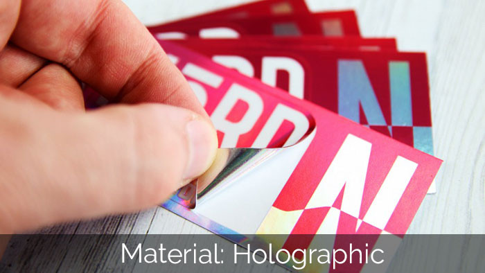 A holographic nord kiss cut sticker being peel off the backing paper