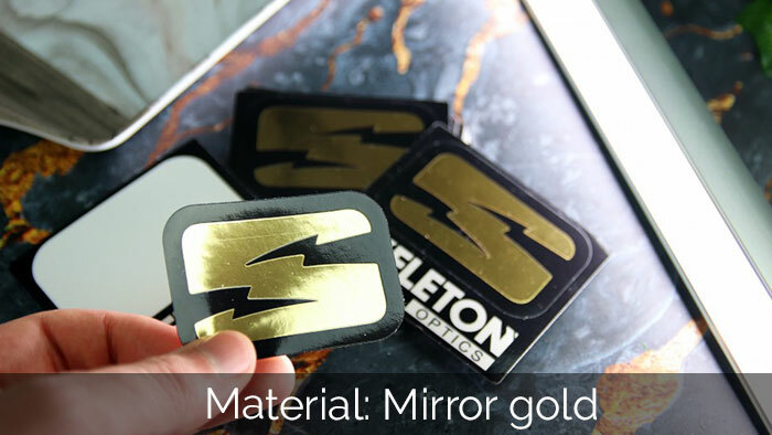 Mirror gold skeleton kiss cut sticker peeled in a hand
