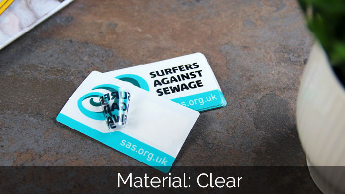 Clear surfers againt sewage kiss cut stickers on a kitchen worktop