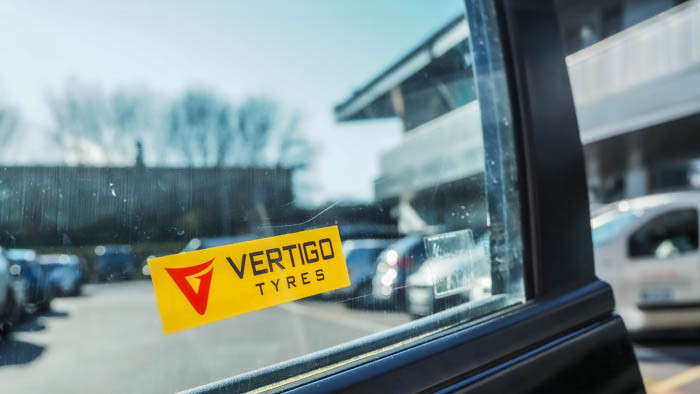 Vertigo tyres yellow and red front adhesive sticker on a car