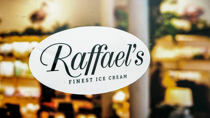 Raffael's oval front adhesive sticker applied to the inside of an ice cream parlour window