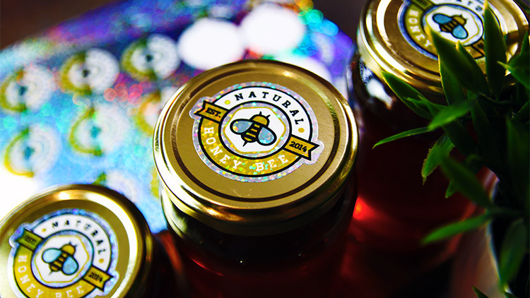 Glitter die cut labels on sheets in full colour on clear glass honey jars