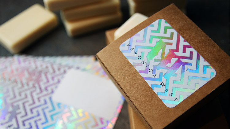 Holographic labels on sheets in full colour on a cardboard soap packaging box