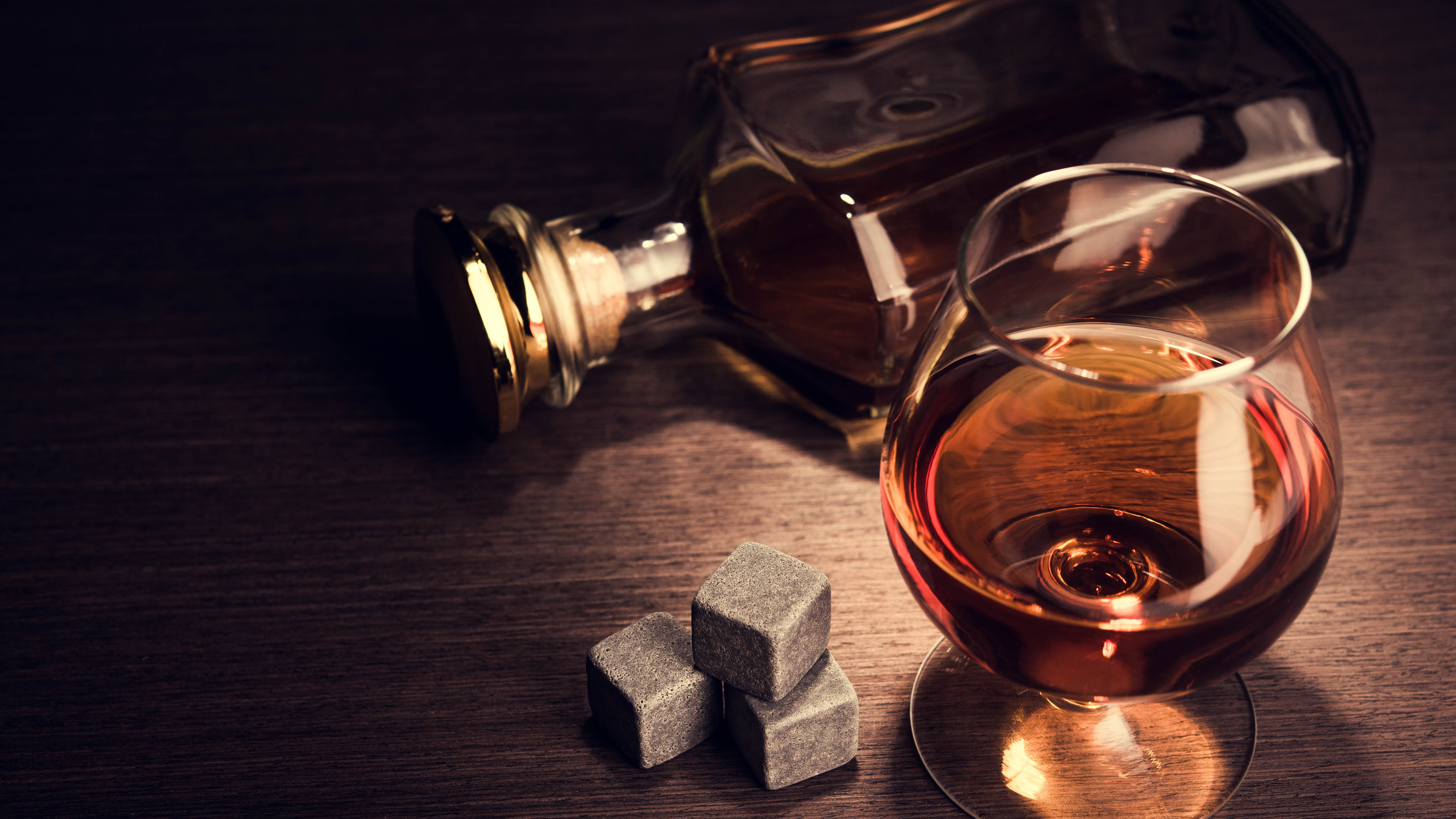 cognac-flat-lay-bottle-glass-and-cubes.jpg