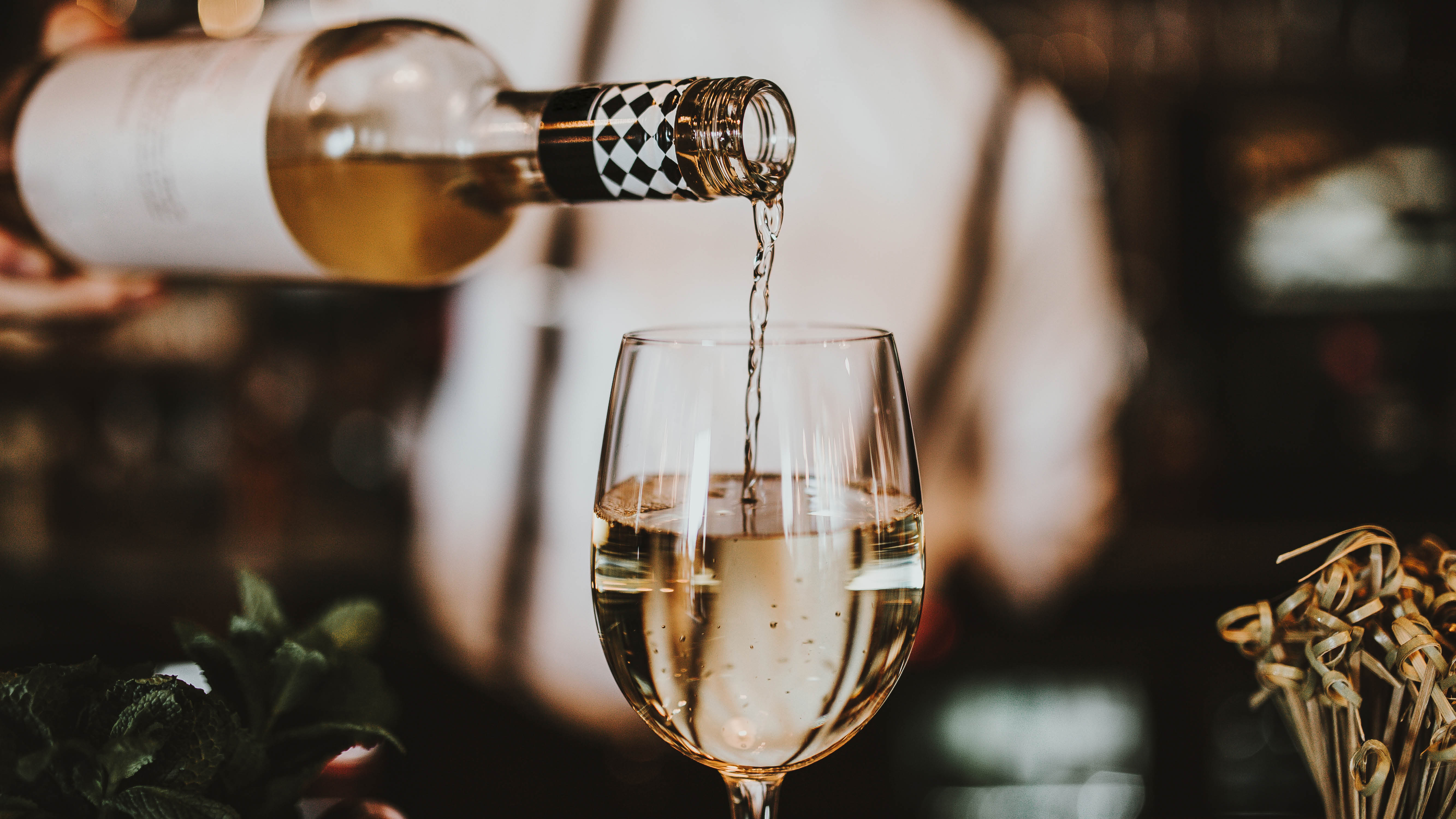wine-pouring-white-wine-into-glass-close-up.jpg