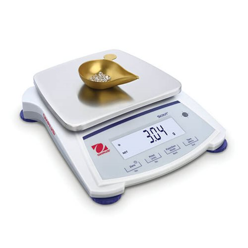 OHAUS SJX 1502NE being used to weigh diamonds and jewelry