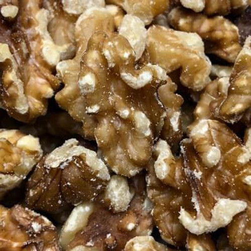 Raw shelled walnuts. No shell. California grown. Sold by the lb.