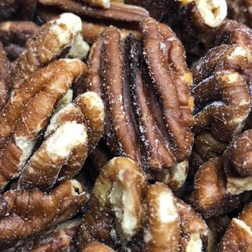 Salted Pecan Halves. Sold by the lb. Pecan halves are roasted in natural coconut oil. Salt added.