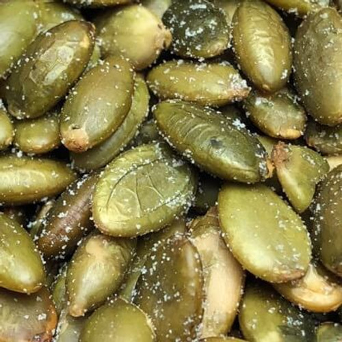Salted pepitas (shelled pumpkin seeds). Sold by the lb. Pepitas are roasted in natural coconut oil. Salt added. Made fresh for great taste. Packed fresh for big smiles.