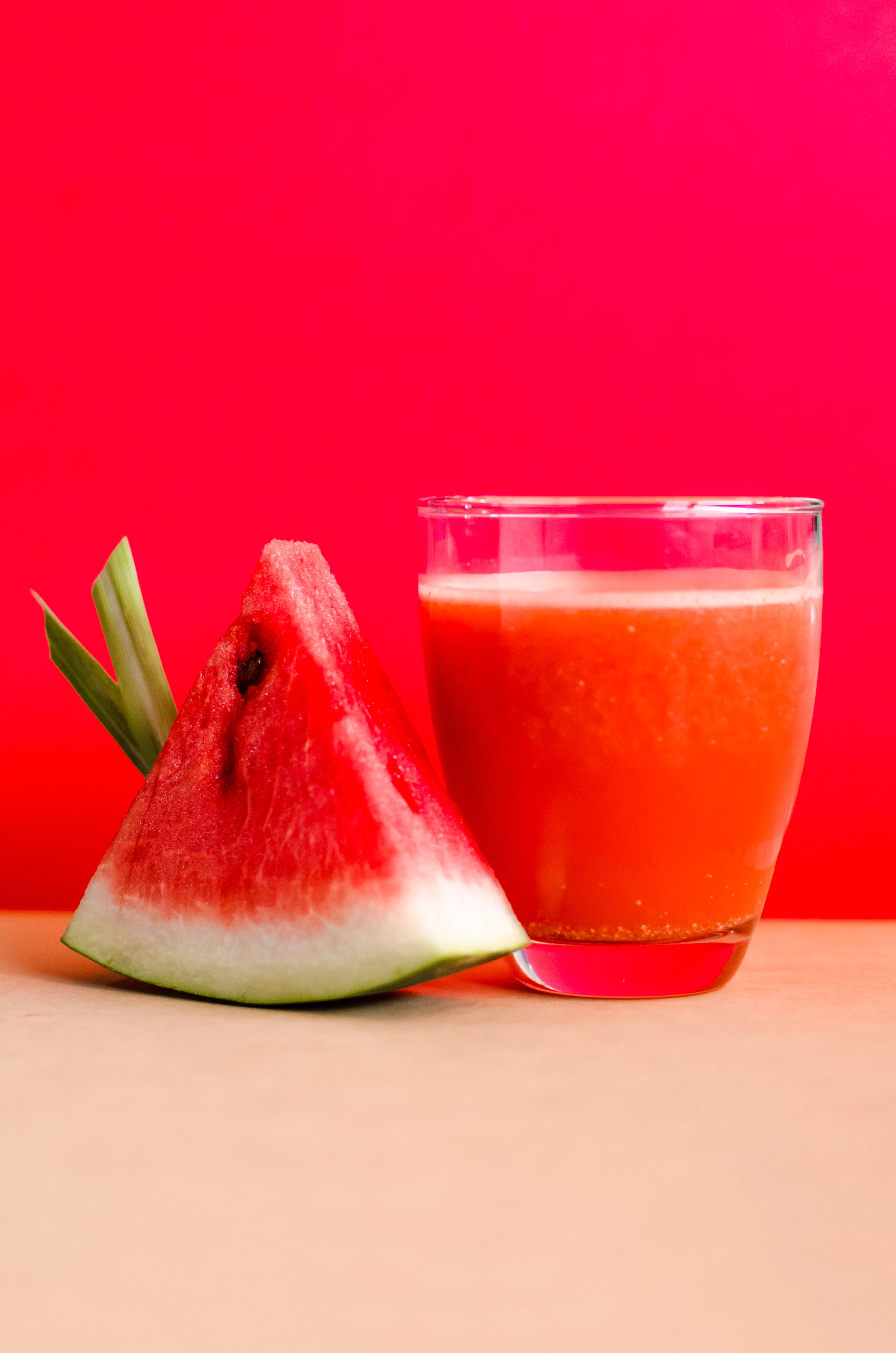 watermelon-shake-filled-glass-cup-beside-sliced-watermelon-1337825.jpg