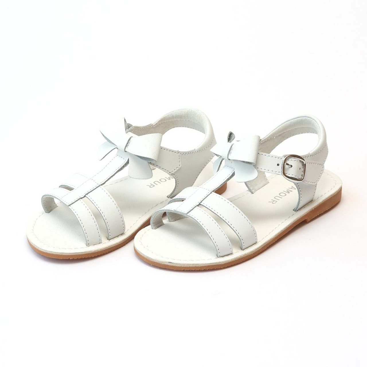 fe6807af756dd Janie T-Strap Bow White Sandal. Now   42.00. (You save ). Availability  In  Stock  SKU  ISCL-K470S-18  Weight  16 Ounces
