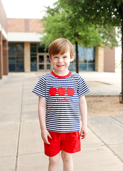 little boy in a red and stripes short set