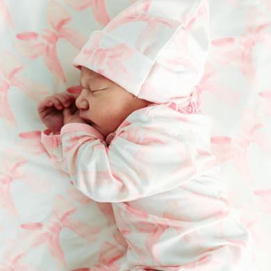 sleeping baby in a ribbon pajamas