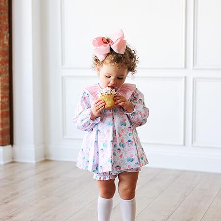little girl in cute birthday pajama
