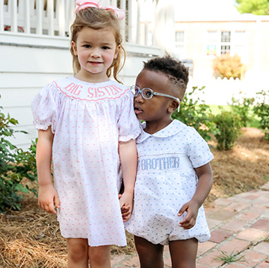 kids in matching smocked outfits