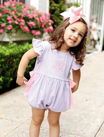 pretty little girl in smocked bow bubble