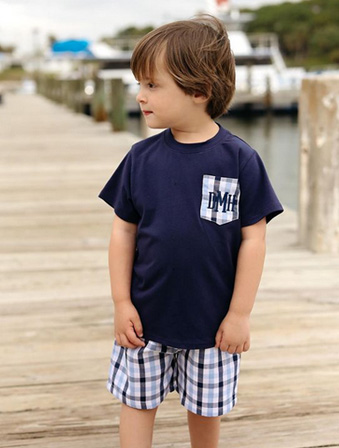 little boy in a blue and check short set